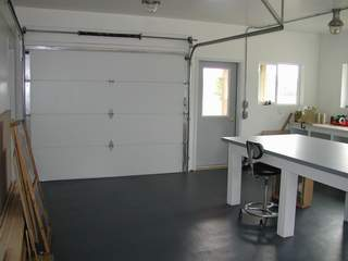 Once Of The Features Of This Building Is A Large 9 Foot Insulated Garage  Door That Can Be Opened During Nice Weather.